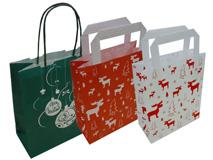 Tragetaschen aus Kraftpapier mit Weihnachtsmotiv bedruckt